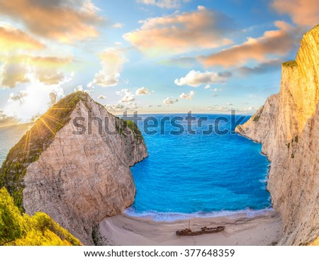 Navagio beach with shipwreck against colorful sunset on Zakynthos island in Greece