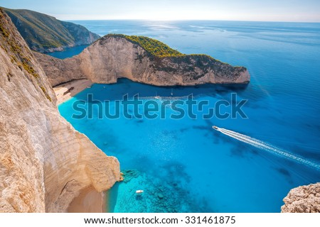 Navagio beach with shipwreck and motor boat on Zakynthos island in Greece - stock photo