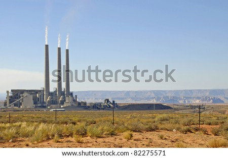 Navajo Power Generating Station, Page AZ, surrounded by large piles of coal. - stock photo
