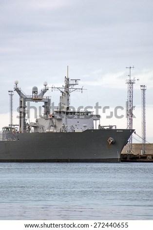 Naval auxiliary ship in the port.