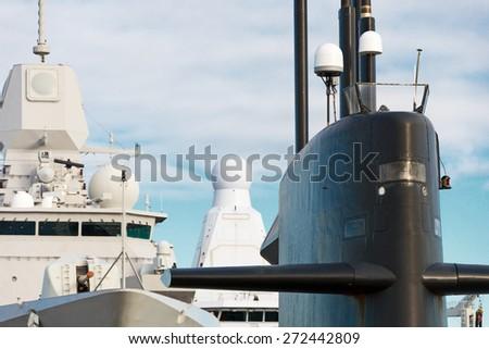 Naval fleet. Submarine and warships with guns. - stock photo