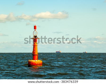 Navigation buoy at the edge of a fairway. - stock photo