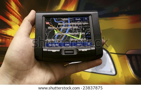 Navigation sistem in a man hand - stock photo