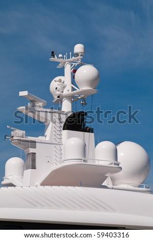 Navigation system antennas of big white motor yacht - stock photo