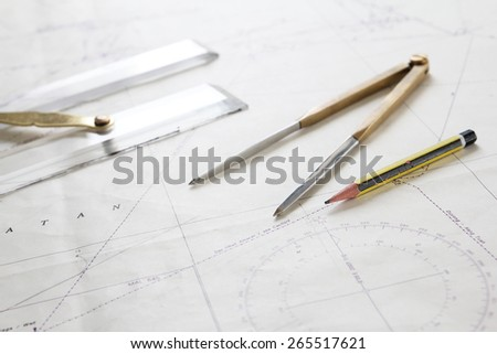 Navigation tools on map aboard ship  - stock photo