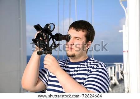 navigator on bridge of vessel - stock photo