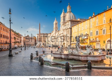 Navona Square at dawn with birds flying , Rome. On the foreground the magnificent Neptune fountain - stock photo