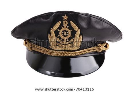 Navy black leather cap with an emblem on a white background - stock photo