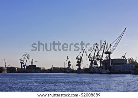 navy cranes in St-Petersburg port - stock photo