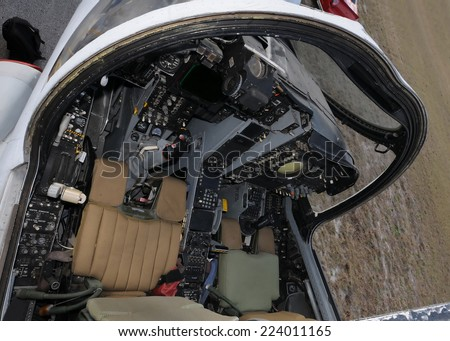 Navy jetfighter cockpit seen from above - stock photo