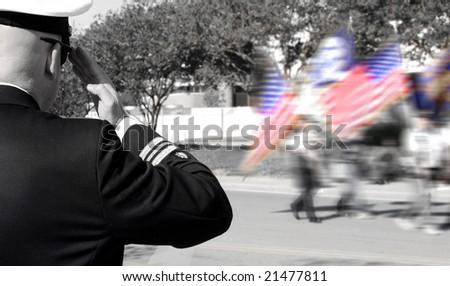 Navy officer saluting veterans in parade - stock photo