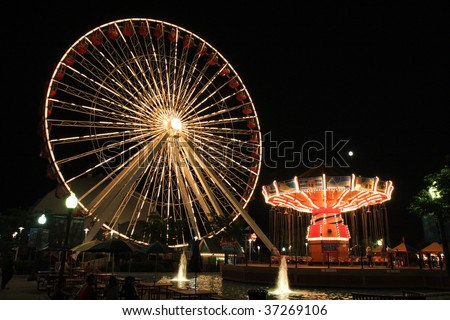 Navy Pier amusement park with rides at night in Chicago - stock photo