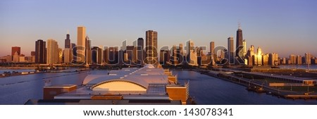 Navy Pier and Chicago skyline at sunrise, Chicago, IL - stock photo