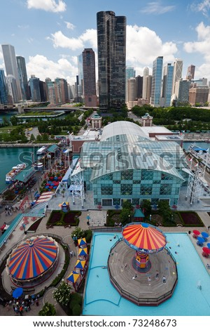 Navy Pier in Chicago, skyscrapers in the background - stock photo