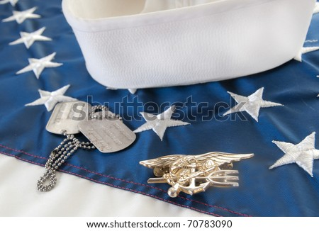 Navy SEAL trident on flag - stock photo