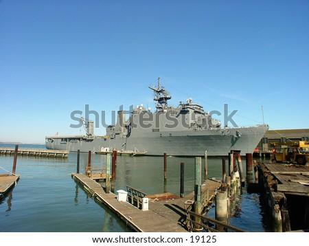 Navy ship at the docks. - stock photo