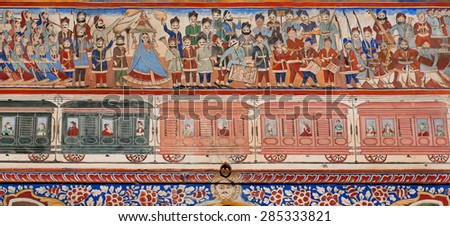 NAWALGARH, INDIA - FEB 6: Crowd of people on train station on naive style fresco of historical Haveli house on February 6, 2015. With pop. of 100000, Nawalgarh is education center of Shekhawati area - stock photo