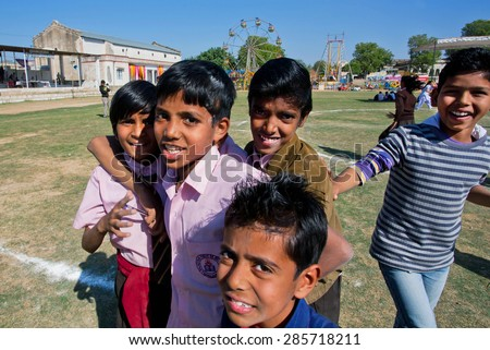 NAWALGARH, INDIA - FEB 6: Unidentified boys jumping on the yard of indian village school on February 6, 2015 in Rajasthan. With population of 100000, Nawalgarh is education center of Shekhawati area - stock photo