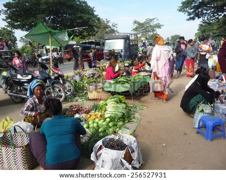 NAYPYITAW/MYANMAR-JANUARY14:People selling and buying fresh fruits and vegetables on January 14,2015 in NayPyiTaw downtown.Usually market in Myanmar is open every five days by turn around among market - stock photo