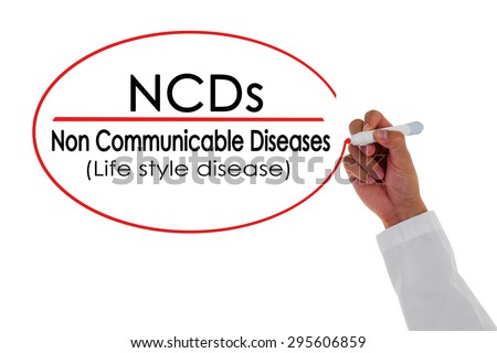 NCDs,Doctor hand writing Non Communicable Disease message.
