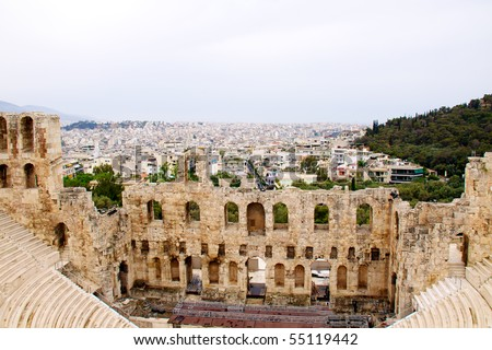 ncient theatre of Herodes Atticus is a small building of ancient Greece used for public performances of music and poetry, below on the Acropolis and in background dwelling of metropolis Athens