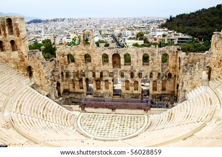 ncient theatre of Herodes Atticus is a small building of ancient Greece used for public performances of music and poetry, below on the Acropolis and in background dwelling of metropolis Athens - stock photo