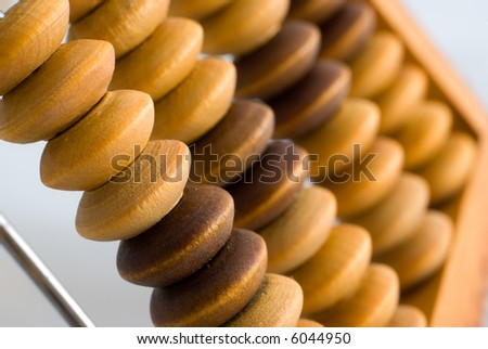 Near-macro shot of old abacus - stock photo