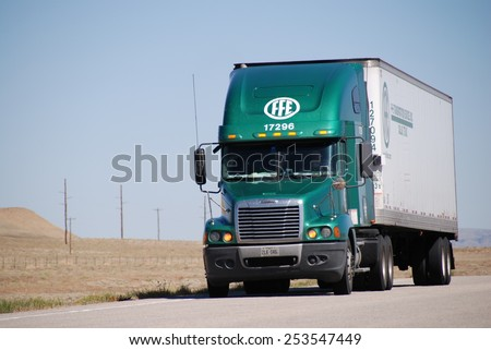NEAR MOAB, UT, USA - JUNE 7, 2008: a truck drives on Route 191 near Moab. Trucks carry nearly 70 percent of all freight transported annually in the U.S. - stock photo