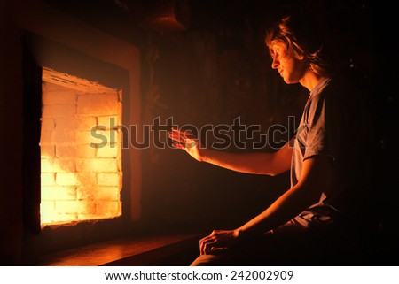 Near the fireplace - stock photo