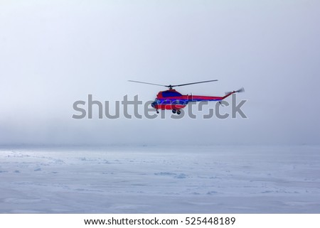 Near the North pole. Ship's helicopter in fog at Arctic ocean (pack ice), air transport in bad weather conditions (utility aviation, leisure aviation)