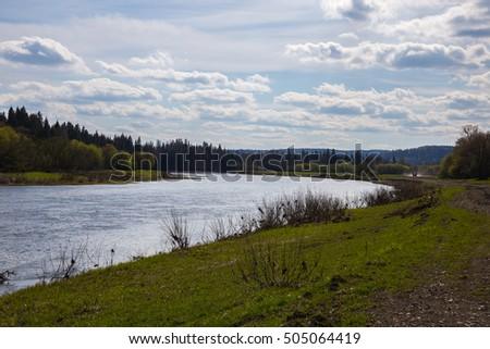Near the river. The natural landscape and clouds.