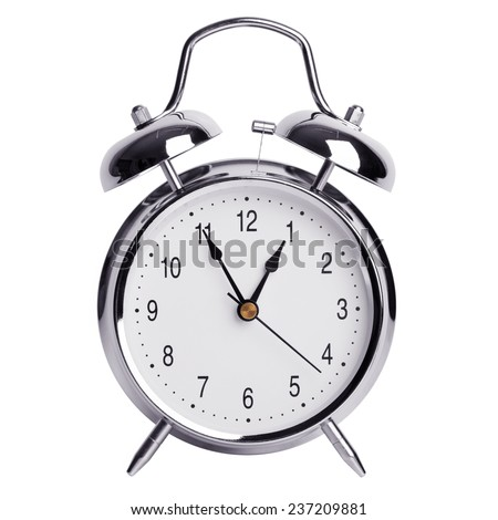 Nearly an hour on a round alarm clock - stock photo