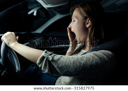 nearly sleeping driving woman in the night - stock photo