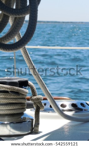 Neat lines on a sailboat used for masts cruising on the Atlantic Ocean.