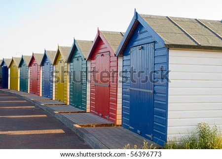 Neat row of beach huts in Devon, UK - stock photo