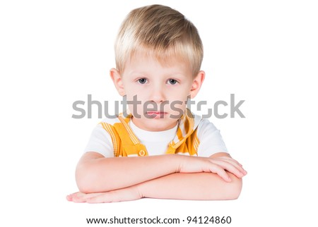 neat young boy sitting at table isolated on white background - stock photo