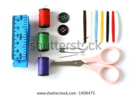 Neatly arranged sewing kit. - stock photo