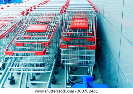 Neatly arranged shopping cart, waiting for customers to use. - stock photo