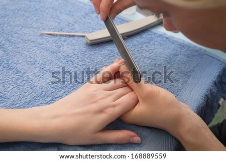 neatly cut nails nail file - stock photo