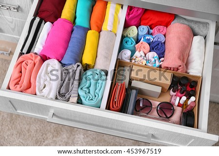 neatly folded clothes accessories chest drawers stock photo 455539030 shutterstock. Black Bedroom Furniture Sets. Home Design Ideas