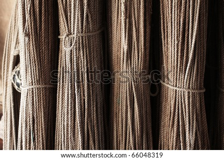 Neatly hanged old fishing nets - stock photo