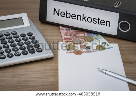 Nebenkosten (german aditional costs) written on a binder on a desk with euro money calculator blank sheet and pen