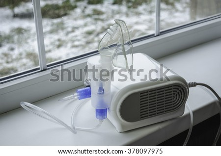 nebulizer inhaler treatment of the common cold - stock photo