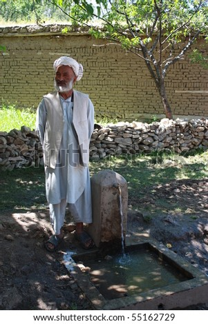 NECHEM, AFGHANISTAN - MAY 31: A man stands beside a running tap newly installed by Afghanaid on May 31 2010 in Nechem, Afghanistan