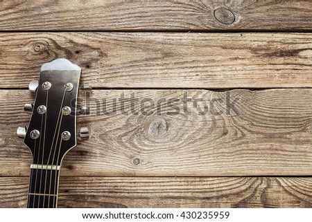 Neck guitar on the background of old grunge boards. Place for text. Top view - stock photo