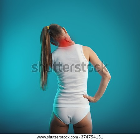 Neck injury and ache. Young female in underwear suffering from vertebra problem or scoliosis.   - stock photo