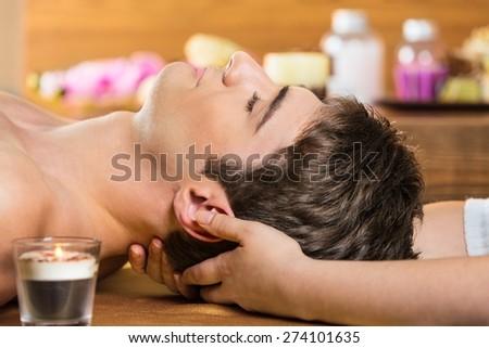 Neck. Masseur doing neck massage on man in the spa salon. - stock photo
