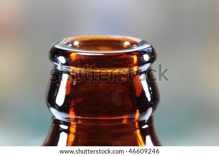 Neck of an old stubby beer bottle - stock photo