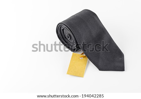 neck tie and cost tag on a white background - stock photo