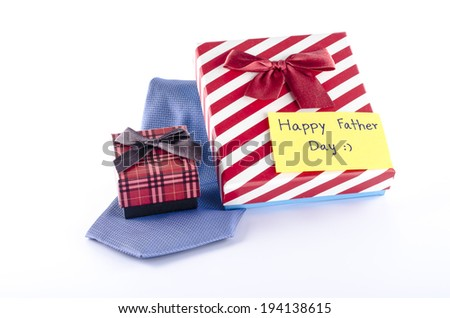 neck tie and two gift boxes with card tag write happy father day word on a white background